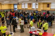 WATERBURY, CT. 27 October 2019-102719BS685 - People gather in the Sacred Heart High School cafeteria for registration prior to the start of the eleventh annual walk and race fundraiser for the St. Vincent DePaul Mission of Waterbury on Sunday. Bill Shettle Republican-American