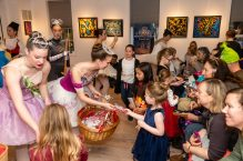 """WOODBURY, CT. 24 November 2019-112419BS222 - Main Street Ballet dancer Tate Dunbar, 15, of Bethlehem, center hands out a treat to Penny Frantz, 4, of Southbury, during a performance of the popular Christmas Tale """" The Nutcracker"""" for children and families at the Woodbury Public Library gallery on Sunday. Bill Shettle Republican-American"""