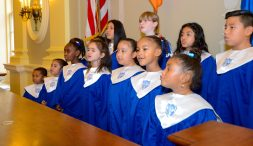 """Members of the Waterbury Police Activities League chorus, sing """"God Bless America"""" after leading the room in the Pledge of Allegiance, during the inauguration for newly elected and re-elected officials Sunday at Waterbury City Hall. Jim Shannon Republican-American"""