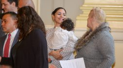 Waterbury District 5 Alderman Brenda L. Cotto, holding her 14-month-old granddaughter, Yasmine Cotto, shares a smile with fellow District 5 Alderman Sandra Martinez-McCarthy after they, along with other Aldermen, were sworn in during the inauguration for newly elected and re-elected officials Sunday at Waterbury City Hall. Jim Shannon Republican-American