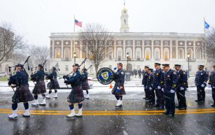 Members of the Police Pipes and Drums of Waterbury, line up in front of City Hall as they prepare to march with city officials, from City Hall to the Basilica of the Immaculate Conception for a Mass, following the inauguration for newly elected and re-elected officials Sunday at Waterbury City Hall. Jim Shannon Republican-American