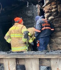 Local and state fire officials investigate the cause of an early morning fire on Washington Road in Woodbury on Wednesday. Steve BighamRepublican-American