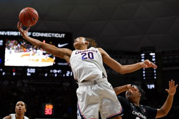 Connecticut's Olivia Nelson-Ododa (20) pulls down a rebound over Cincinnati's IImar'I Thomas, right, in the first half of an NCAA college basketball game, Thursday, Jan. 30, 2020, in Storrs, Conn. (AP Photo/Jessica Hill)