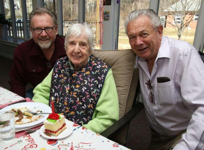 Pauline Anstett of Goshen celebrates her 100th birthday with her sons, Gerald, left, and Richard, both of Goshen. John McKenna Republican-American