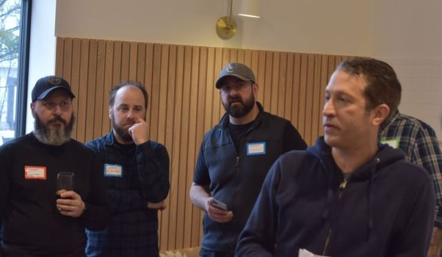 Twelve Percent Beer Project general manager Alex Blank (right) talks with social media fans of Connecticut beer. Will Siss Republican American