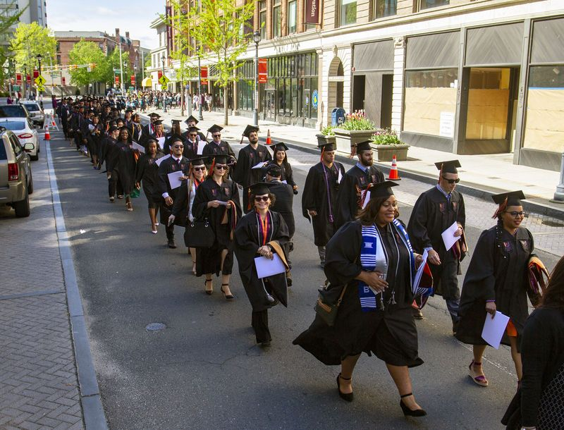 Post University students walk from the Bank Street to the Palace Theater before the start of Post University 2019 Commencement ceremony at the Palace Theater on May 11, 2019. Jonathan Wilcox Republican-American