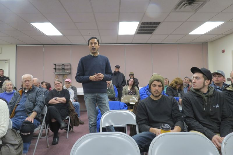 Avery Patel, who will manage a boarding house in Canaan, speaks at Monday