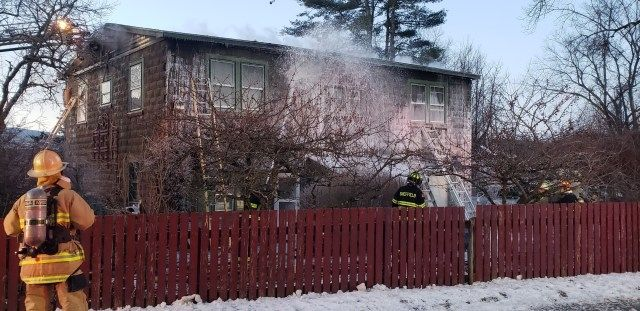 Firefighters respond to a blaze near Route 7 in Canaan on Friday morning. A family of four escaped the home and no injuries were reported. Contributed by Jon Barbagallo
