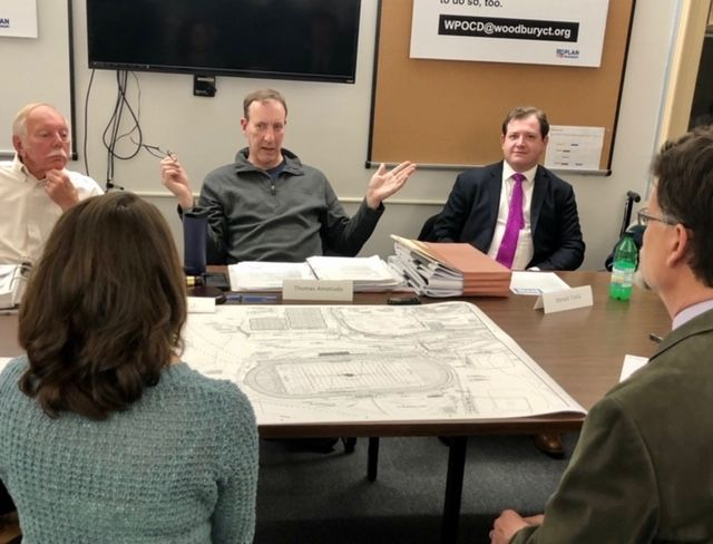 WOODBURY -- Members of the Woodbury Zoning Commission discuss with the Region 14 renovation design team plans to install bleachers and lights for the turf field at Nonnewaug High School.Steve BighamRepublican-American