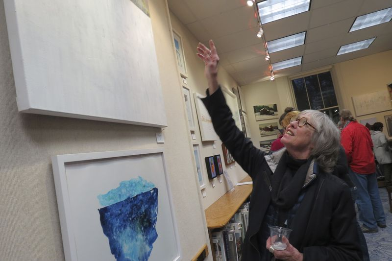 Artist Kathy Wismar explains her painting in the