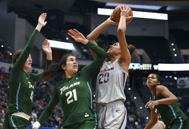 Connecticut's Olivia Nelson-Ododa shoots as Tulane's Mia Heide, left, Tulane's Irina Parau, center, and Tulane's Krystal Freeman, right, defend, in the second half of an NCAA college basketball game, Wednesday, Feb. 19, 2020, in Hartford, Conn. (AP Photo/Jessica Hill)
