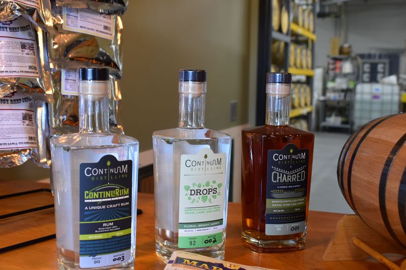 Bottles of Continuum Distilling spirits. (Will Siss Republican-American)