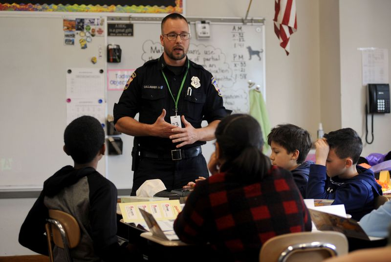 Torrington police officer Michael Gallagher, one of the three DARE officers in Torrington, talks to fifth-graders at Southwest School last week. Gallagher, a DARE officer for the past five years, has included discussions about vaping with his students. Bruno Matarazzo Jr. Republican-American
