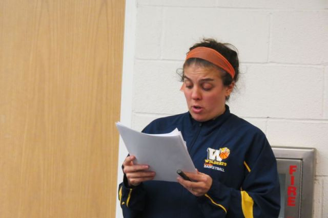 Jennifer Garzone, coach of the MCW football team, reads from a statement at Monday's meeting of the Region 1 Board of Education supporting retaining the program. Ruth Epstein Republican-American