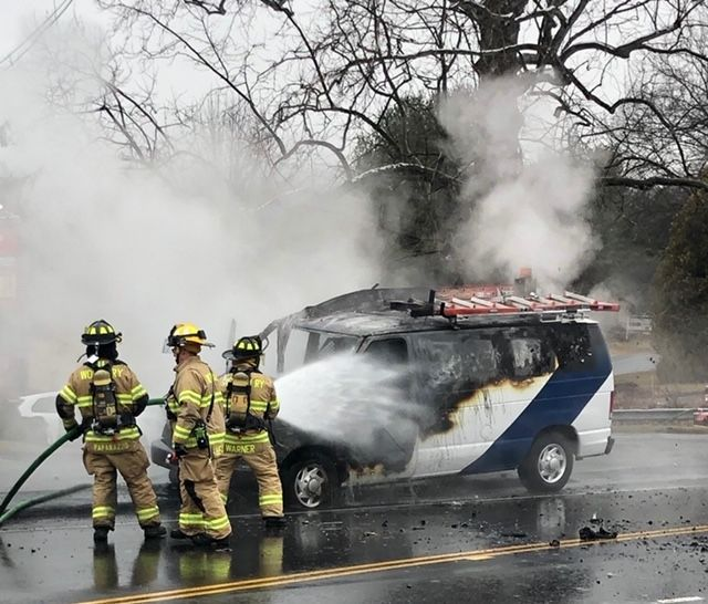 cutline attribution name:Steve Bigham Republican-AmericanFirefighters battle a vehicle blaze on Main Street South Tuesday morning.