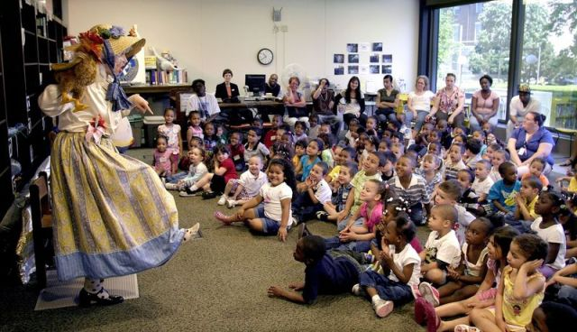 WATERBURY ? Lenka Pichlikova from the Connecticut Commission on the Arts, aka Mother Goose, entertains over 150 children in the New Opportunities, Inc. Early Childhood Division Headstart program during a program held at the Silas Bronson Library in 2009. The library is celebrating its 150th anniversary today. Republican-American Archives