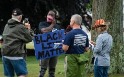 A Black Lives Matter supporter talks with police supporters after he showed up during a rally to support local and national law enforcement Saturday at Seth Thomas Park in Thomaston. Jim Shannon Republican-American