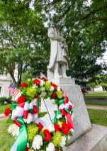 A wreath was laid in front of the Christopher Columbus statue at Waterbury City Hall on Saturday after someone removed the head some time overnight. Jim Shannon Republican-American