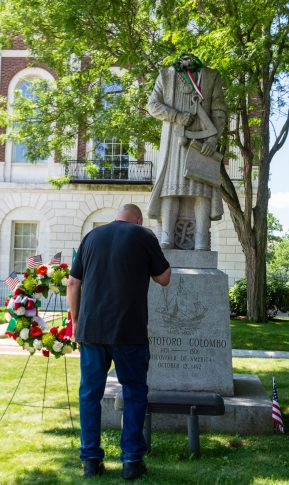 John Silva of Woodbury, pauses for a moment to say a prayer in front of the Christopher Columbus statue in front of Waterbury City Hall on Saturday after someone broke the head off of the statue. Jim Shannon Republican-American