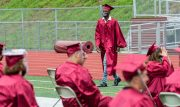 Naugatuck High School graduate Jerry Johnson makes his way back to his seat after receiving his diploma during graduation ceremonies Friday at Naugatuck High School. The school held five separate ceremonies with about 40 graduates at each due to limitations on gatherings. Jim Shannon Republican-American