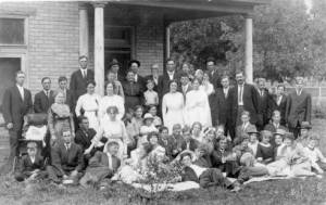 Image of Mapleton Ward Choir in front of a house, circa 1905