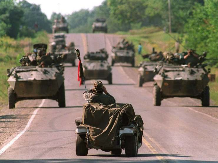 sept. 1, 1990: a mohawk warrior sits in golf cart and uses binoculars to view approaching canadian army armoured vehiches on highway 344 on the kanesatake reserve at oka, que.tom h