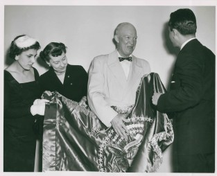 Receiving a gift from President Carlos Castillo Armas of Guatemala, November 9, 1955. Also pictured is President Castillo Armas' wife Odilia Castillo Armas and First Lady Mamie Eisenhower.