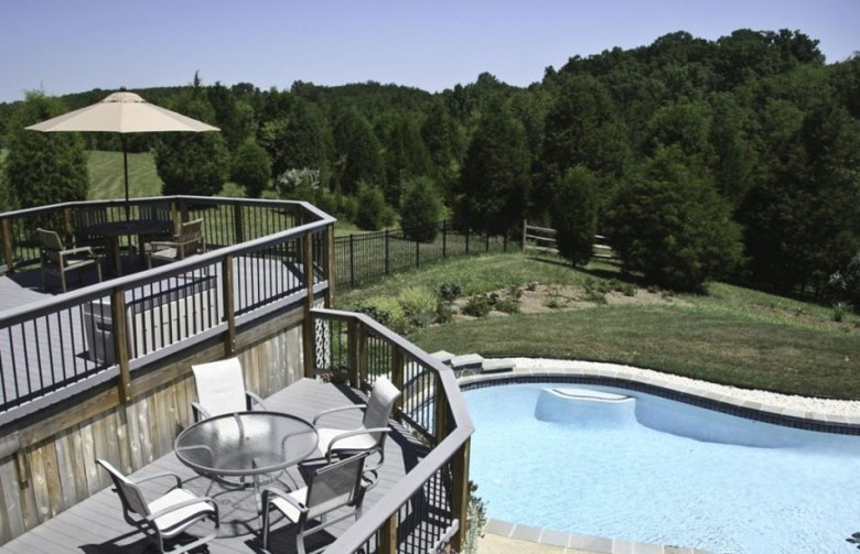The Two-Level Deck Designs Facing The Swimming Pool