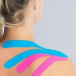 A woman with Kinesio-tape of her shoulder and neck
