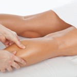 An image of a person having their calf massaged