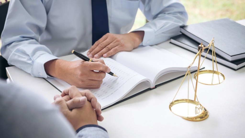 lawyer providing legal information to a client at law office