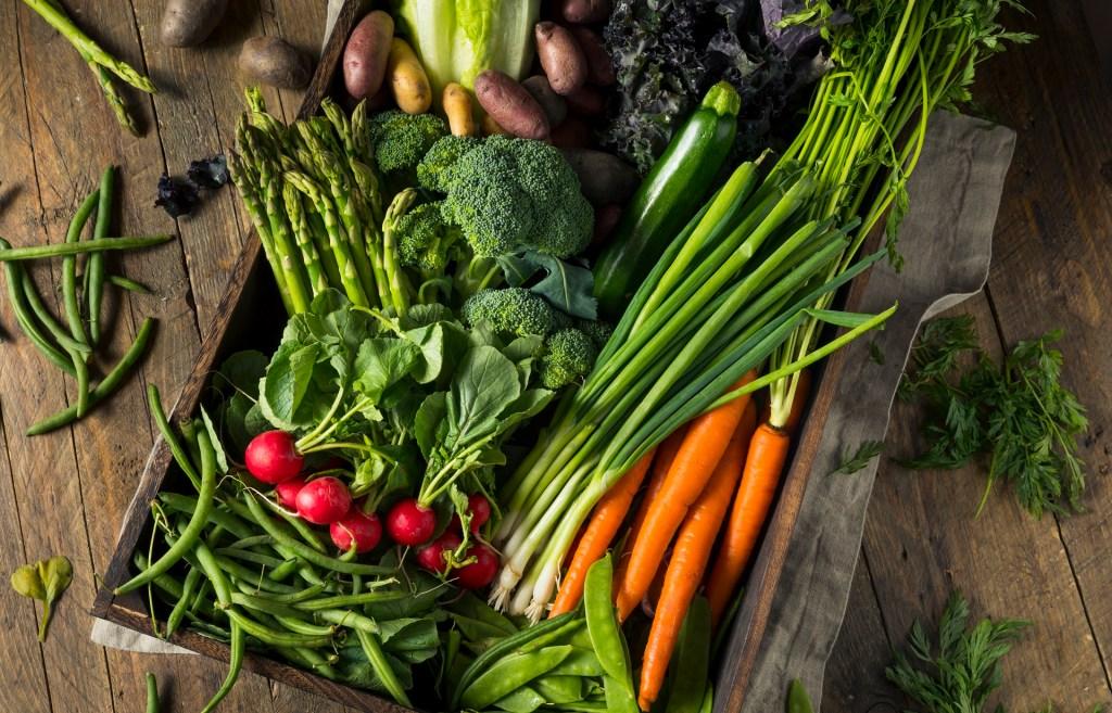 box of seasonal vegetables for a farmer's market