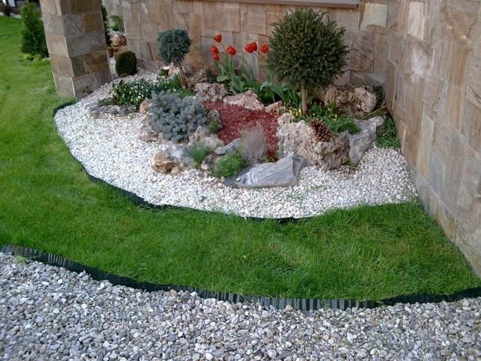 vorgarten gestalten deko mit wei en und schwarzen steinen,