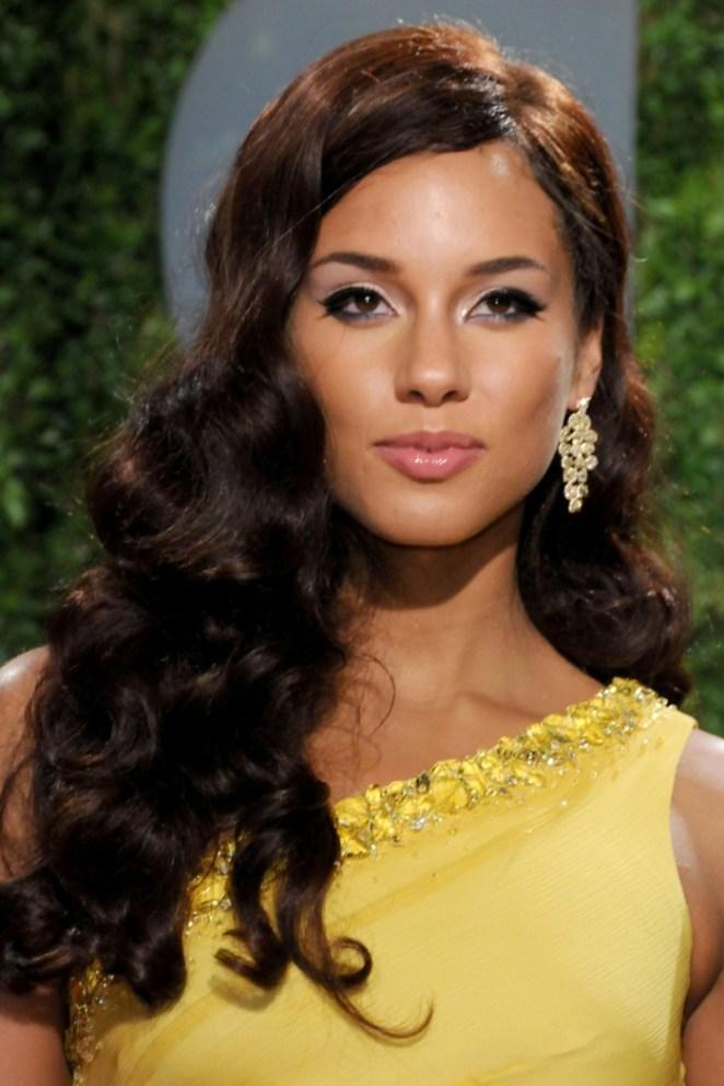 Make long hair yourself, curly black hair, side picks, beautiful earrings, yellow dress