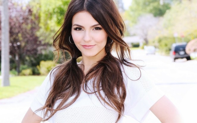 Beautiful hairstyles for long hair, a beautiful girl with a white blouse, brown hair and round earrings