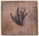 untitled (wood burned with handprint)