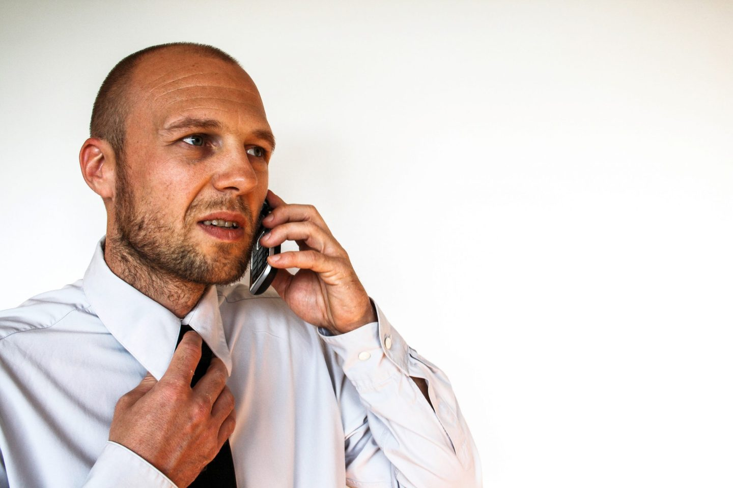 Man feeling anxious during a phone interview