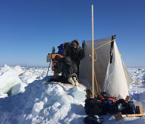 Setting up equipment for . making observations. (Matt Druckenmiller)