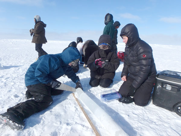 On a sea ice field trip offshore of Utqiagvik, students learn how ice cores are used to study Arctic sea ice.