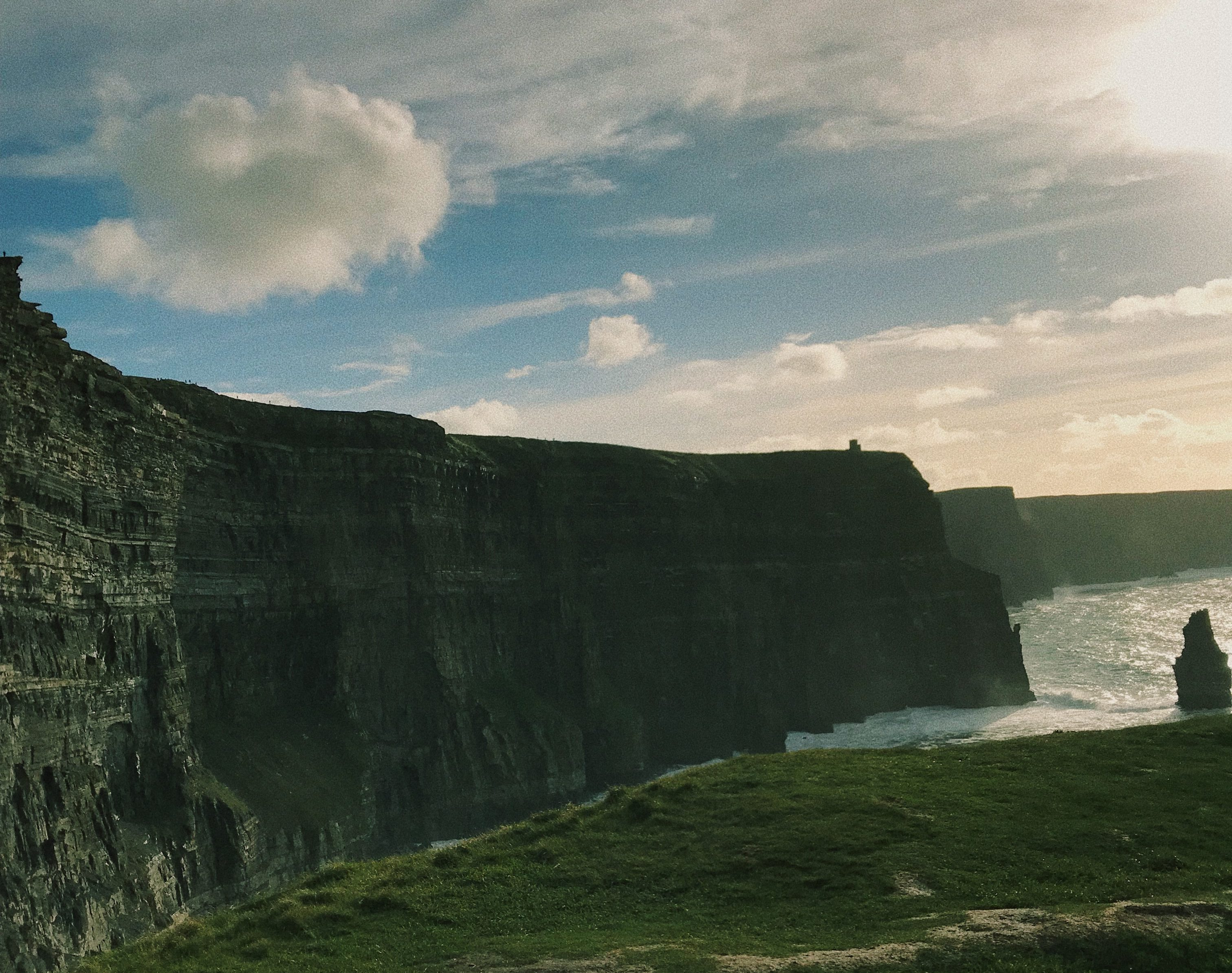 The sun shining on the Cliffs of Moher