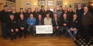 Midwest Donegal vintage Club members pictured with their cheque for E3,135 for Tractor Action, proceeds from their Vintage rally which will go towards  the victims of Flood Damage in the Country. (jmac.ie)