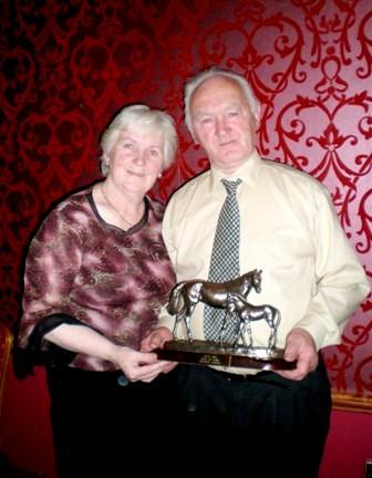Bobby Bolger and Brid with Award