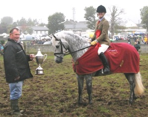 Nicola Phelan on Mr what receives the Cannon Ball Trophy from Ml. Power