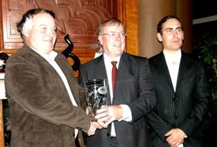 Eamonn Briscoe & son Ciaran accept Award from Society President Dermot Power