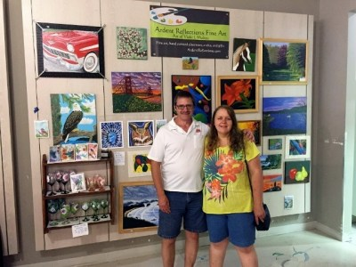 My husband and me standing in front of of my art display at the Kitsap Mall