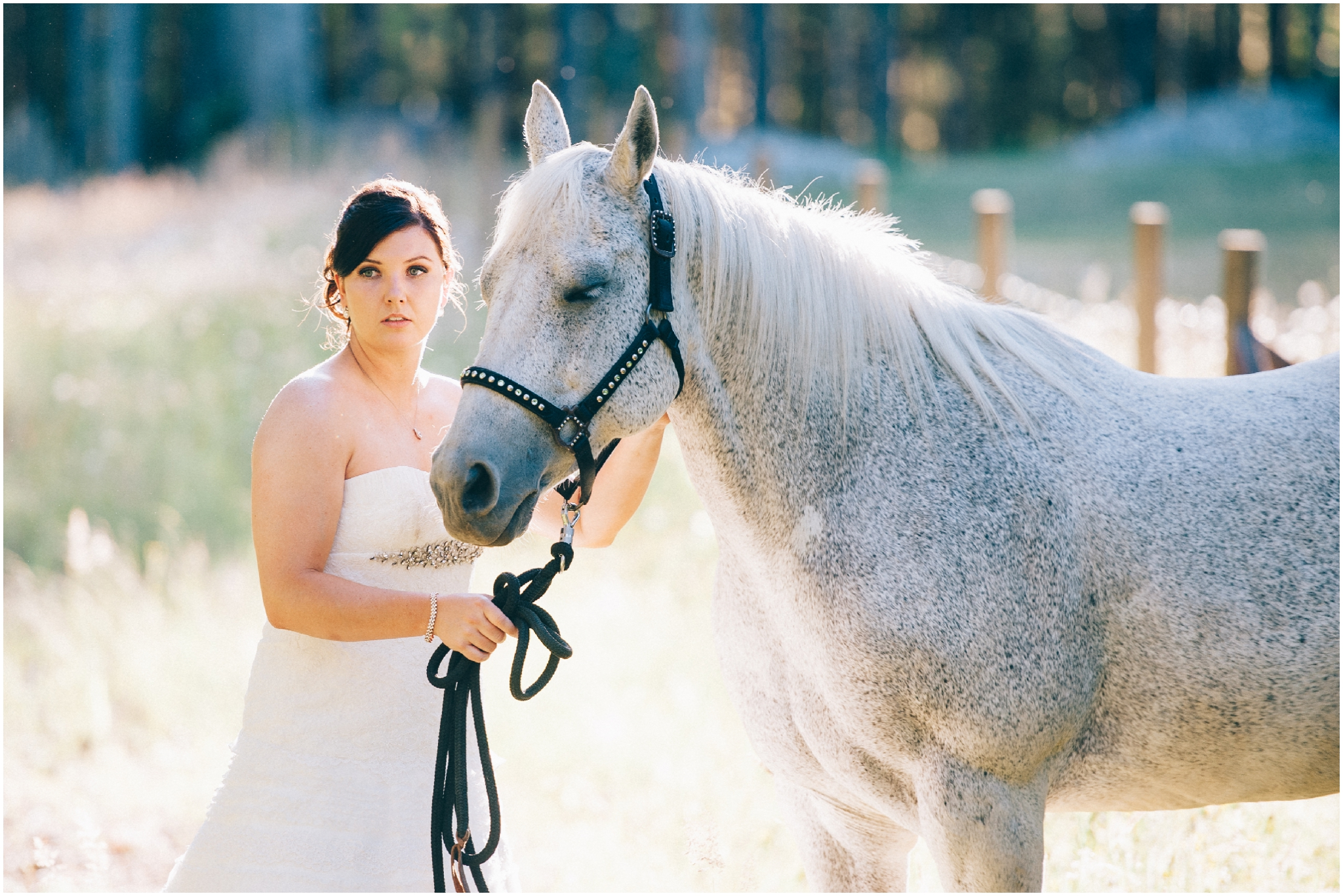 Bride Wedding Photo standing next to a horse by Ardita Kola Photography