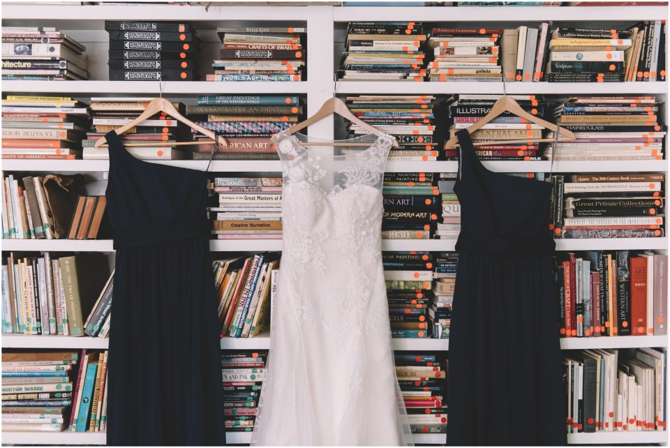 Duke Art Gallery Wedding dress hanging in front of book case