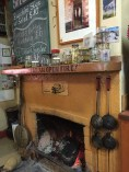Fire place with snake and insect collection on mantel. Silverton