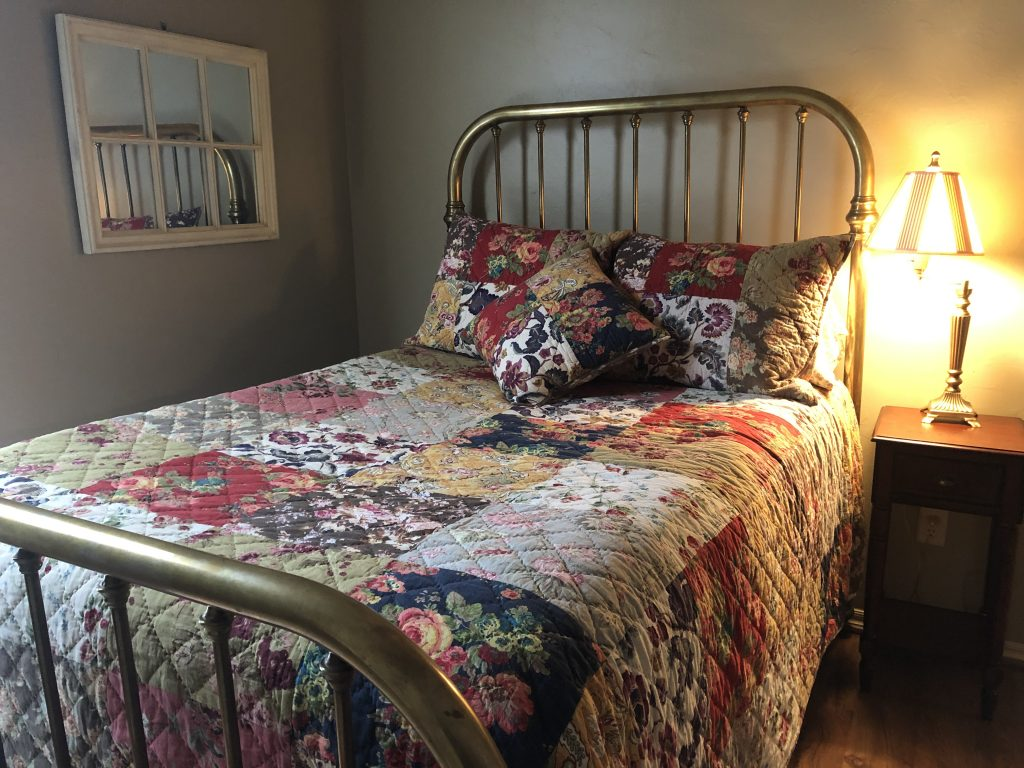 quilted twin bed of temporary home in Oklahoma