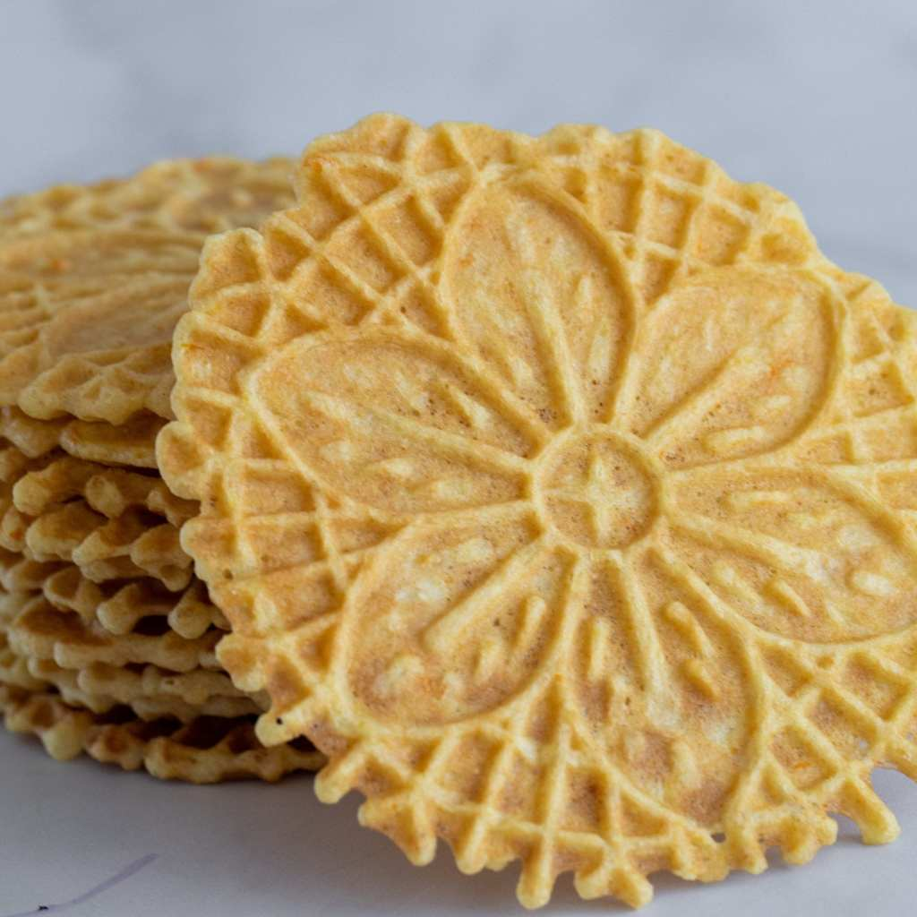 stacked pizzelle cookies stacked in a stack